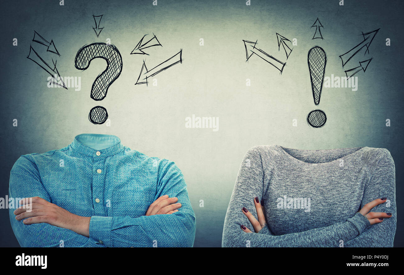 Incognito man and woman with crossed hands and drawn interrogation and exclamation marks instead of head. Introvert and extrovert couple problem and s - Stock Image
