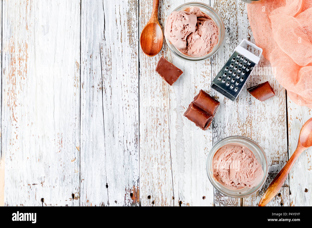 chocolate ice cream ball in a bowl on a white rustic table. Copy space. - Stock Image