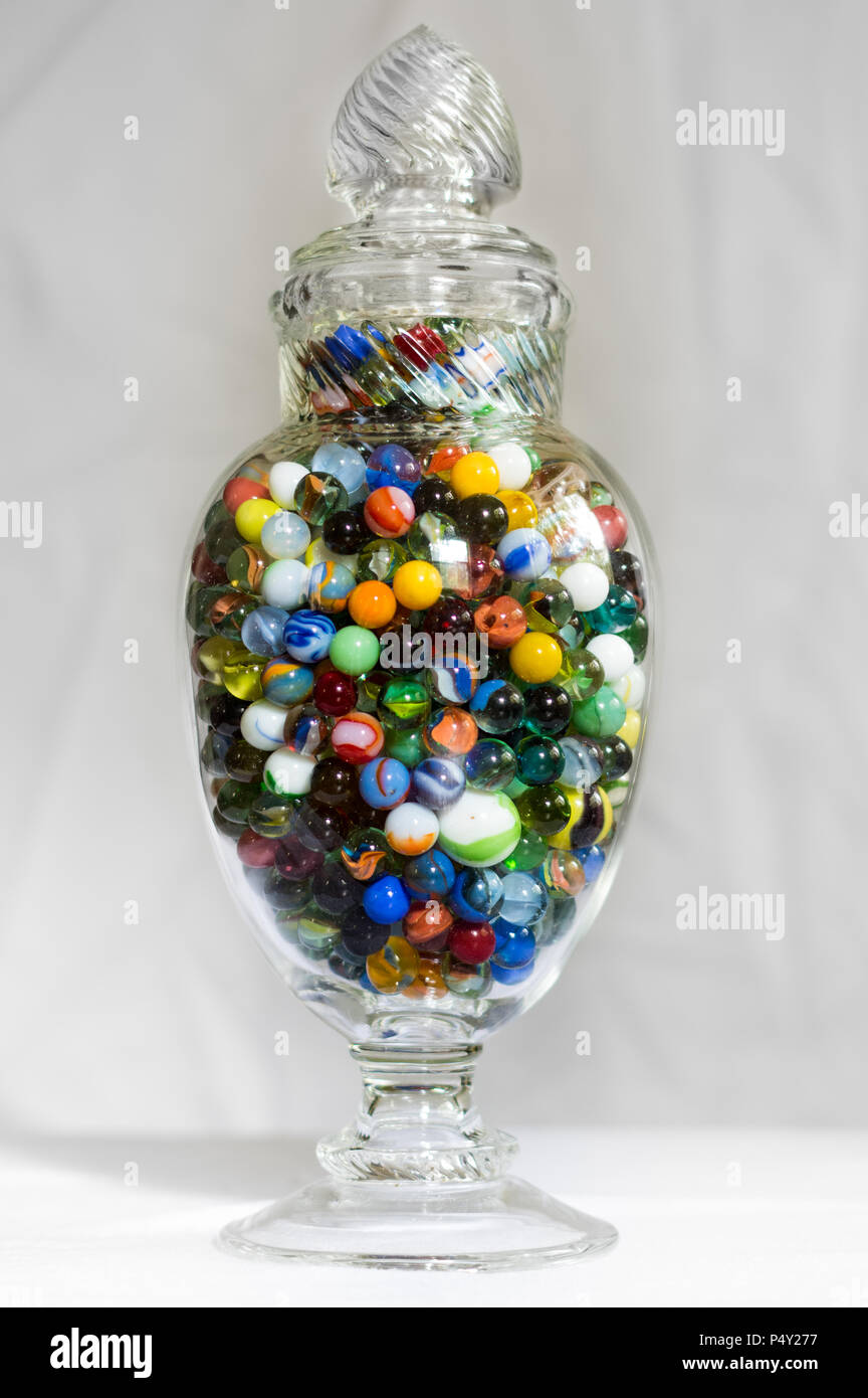 Vintage Glass Vase Filled with Colorful Glass Vintage and Antique Marbles - Stock Image