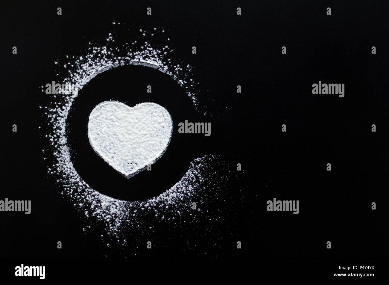 Heart symbol on blackboard. White heart chalk drawing on a school chalkboard with place for text. Romantic love Valentines Day holidays concept. Copy  - Stock Image