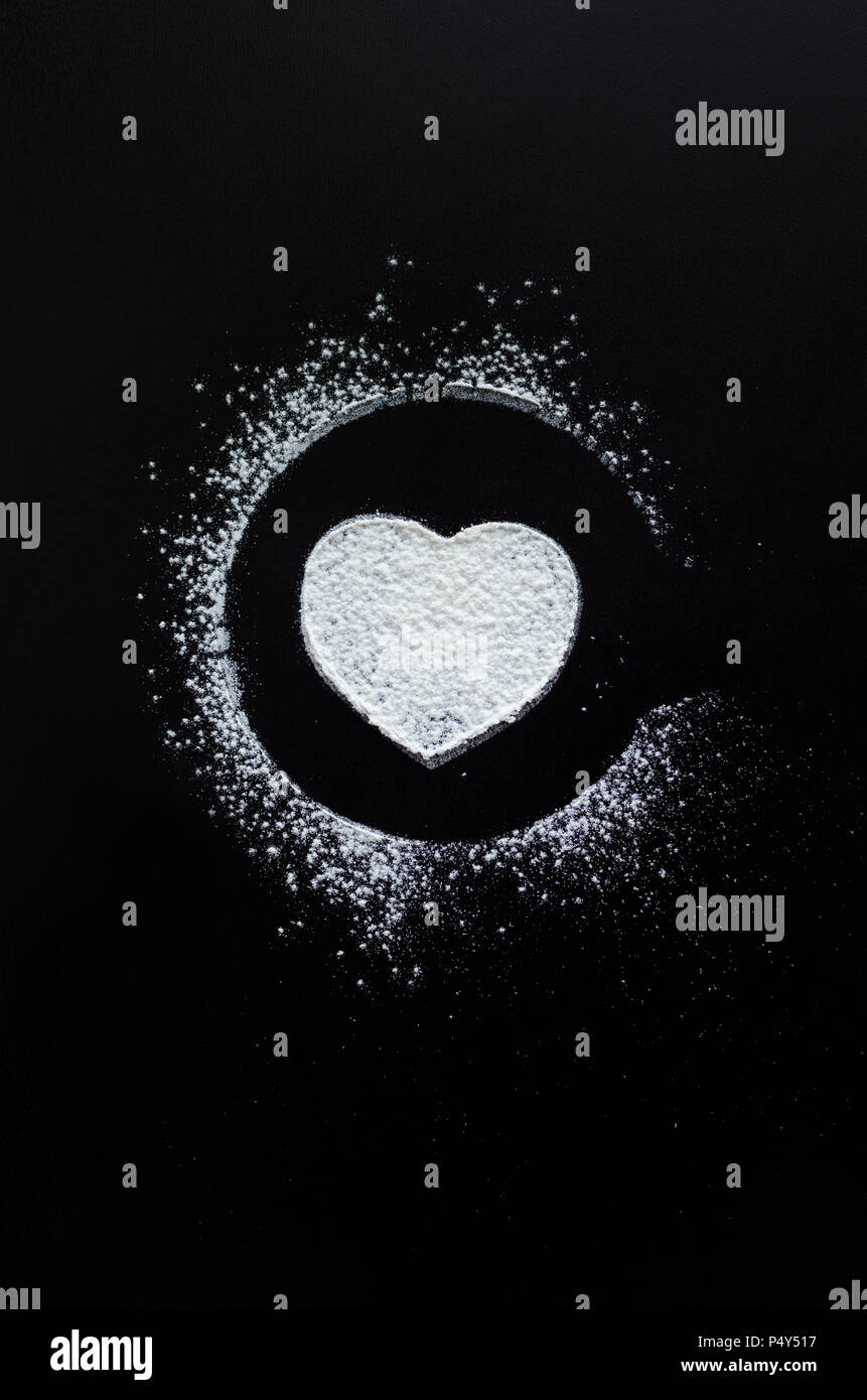 Heart symbol on blackboard. White heart chalk drawing on a school chalkboard. Romantic love Valentines Day holidays concept. - Stock Image