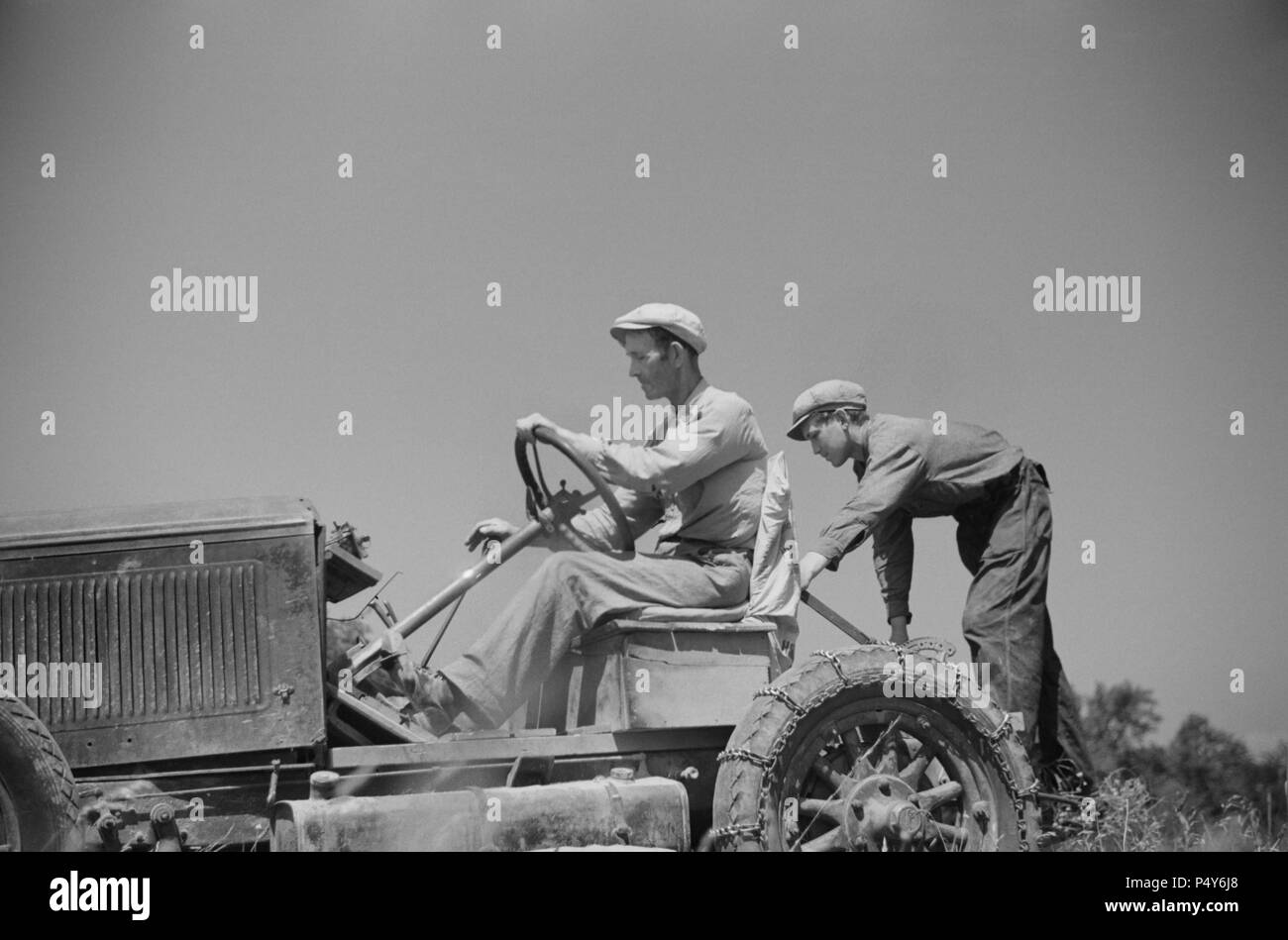 Luke Weldon, Small Farmer, and his son using Ancient Buick as Improvised Tractor. Automobile Purchased in Second-Hand Car Lot for Fifteen Dollars. New Bridgetown, New Jersey, USA, Edwin Rosskam, Farm Security Administration, June 1936 - Stock Image