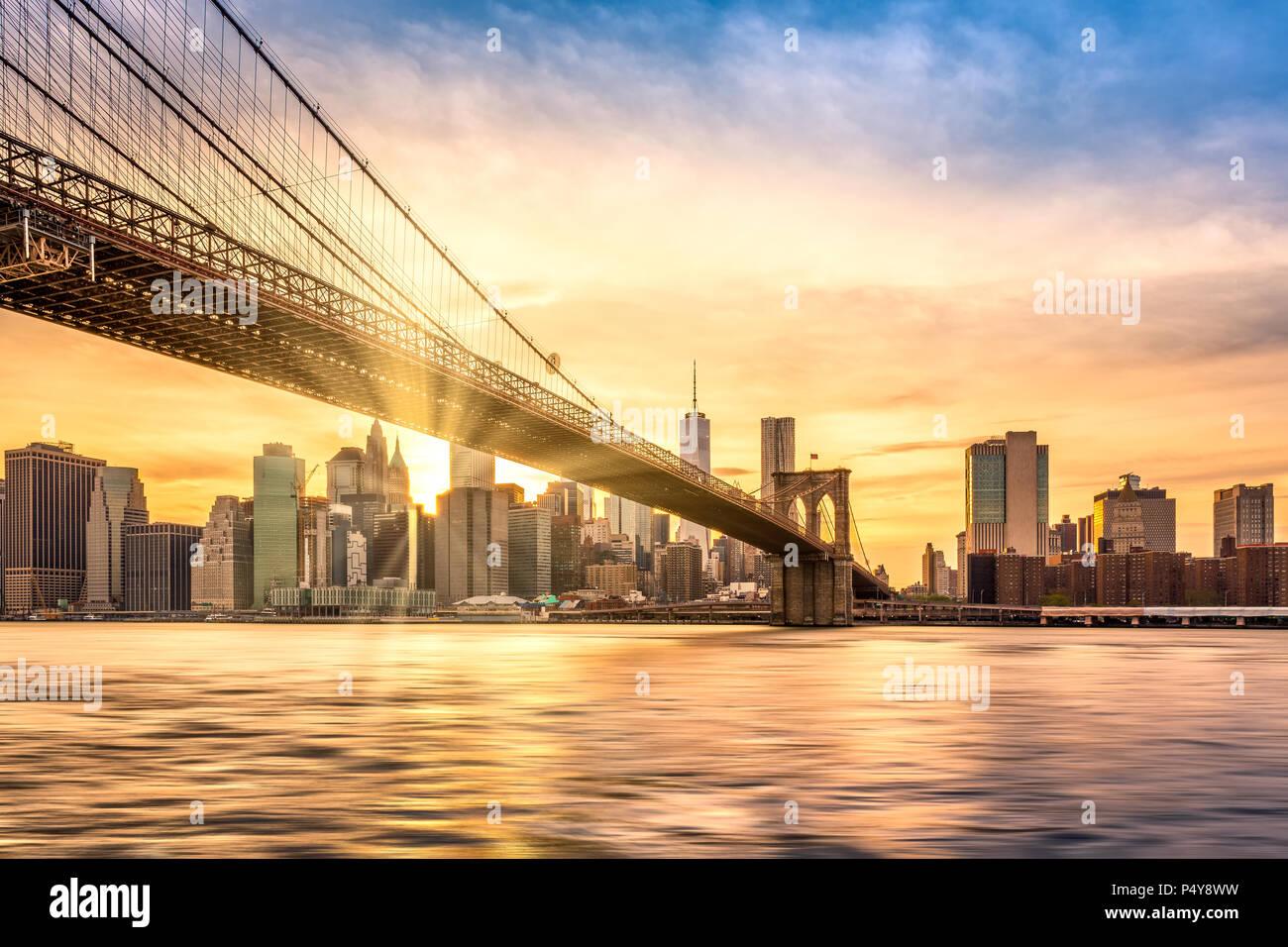 Brooklyn Bridge at sunset viewed from Brooklyn Bridge park, in New York City - Stock Image