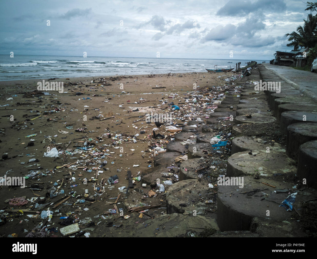 Plastic bags, bottles and other trash polluting beach in Sumatra, Indonesia Stock Photo