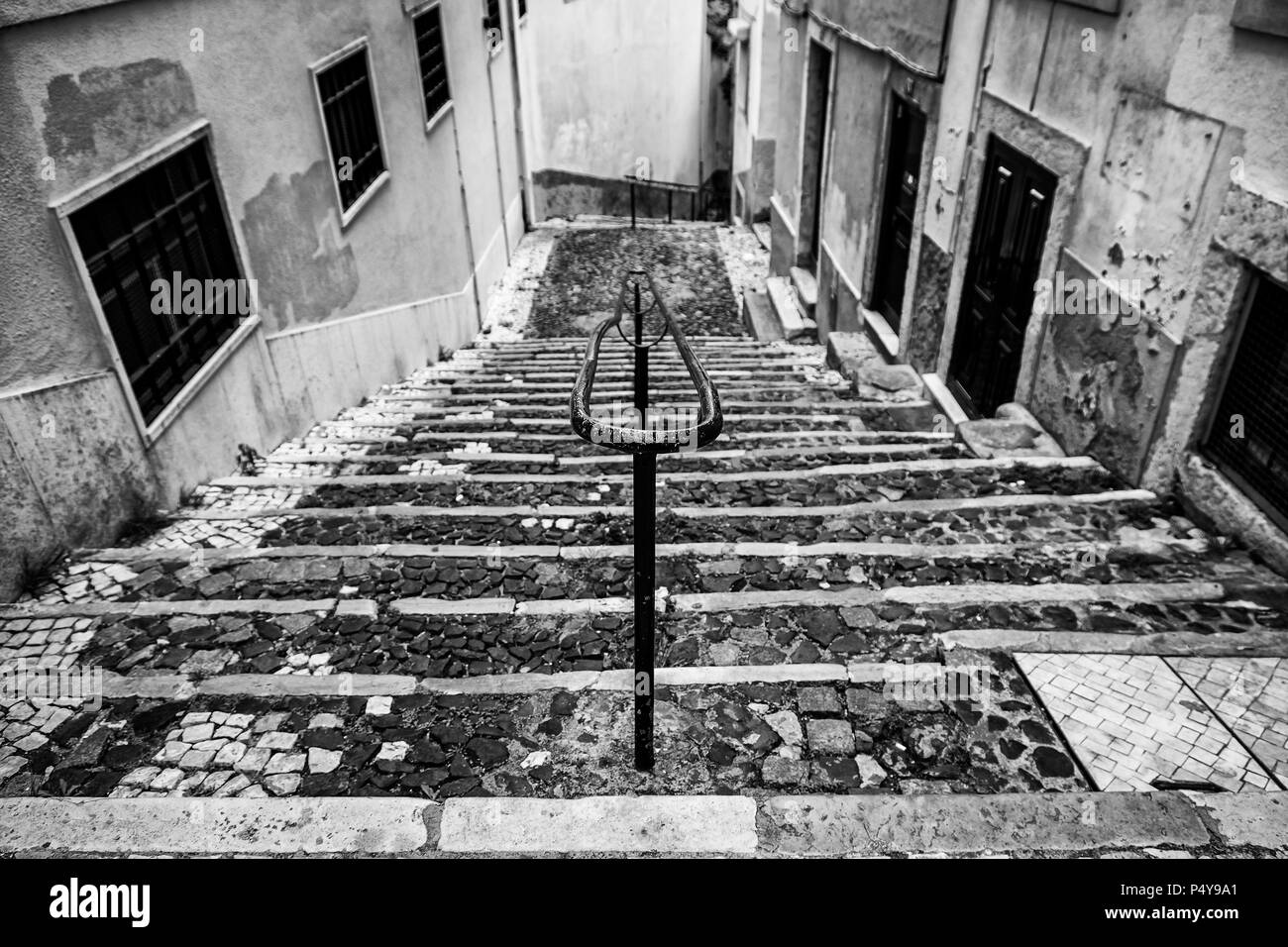 Old stone stairs in Lisbon, detail of stairs in an old street in an old neighborhood in Portugal - Stock Image