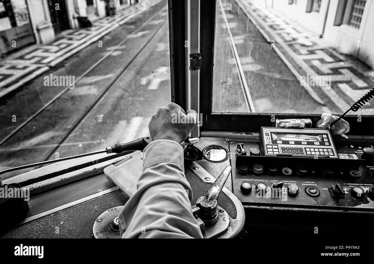 Driver tram in Lisbon, detail of a person wearing an old tram travelers in Portugal - Stock Image