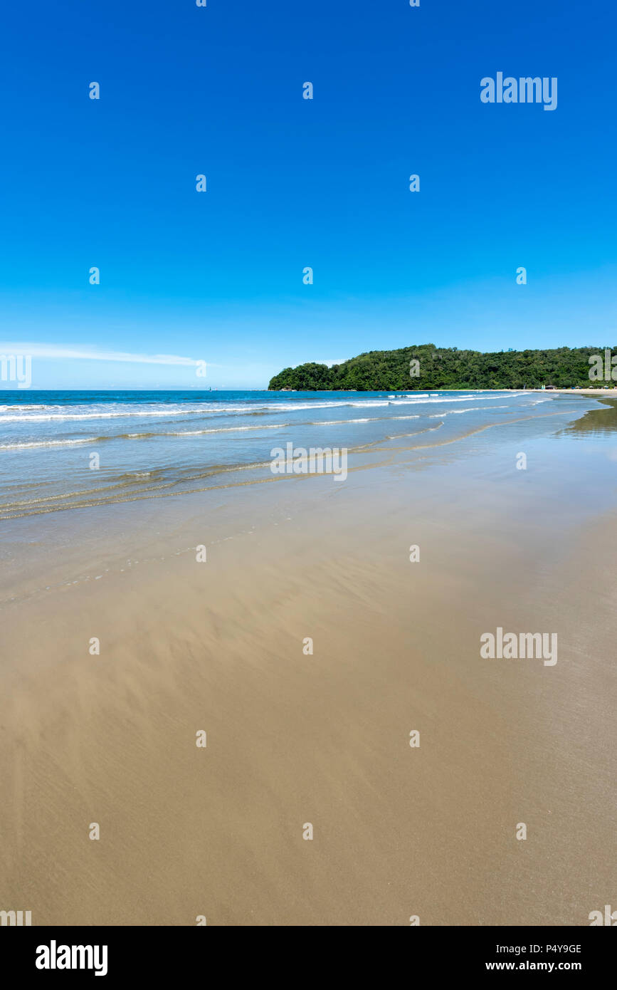 Waves from the South China Sea break on to the beach in Kota Kinabalu, Borneo, Malaysia - Stock Image
