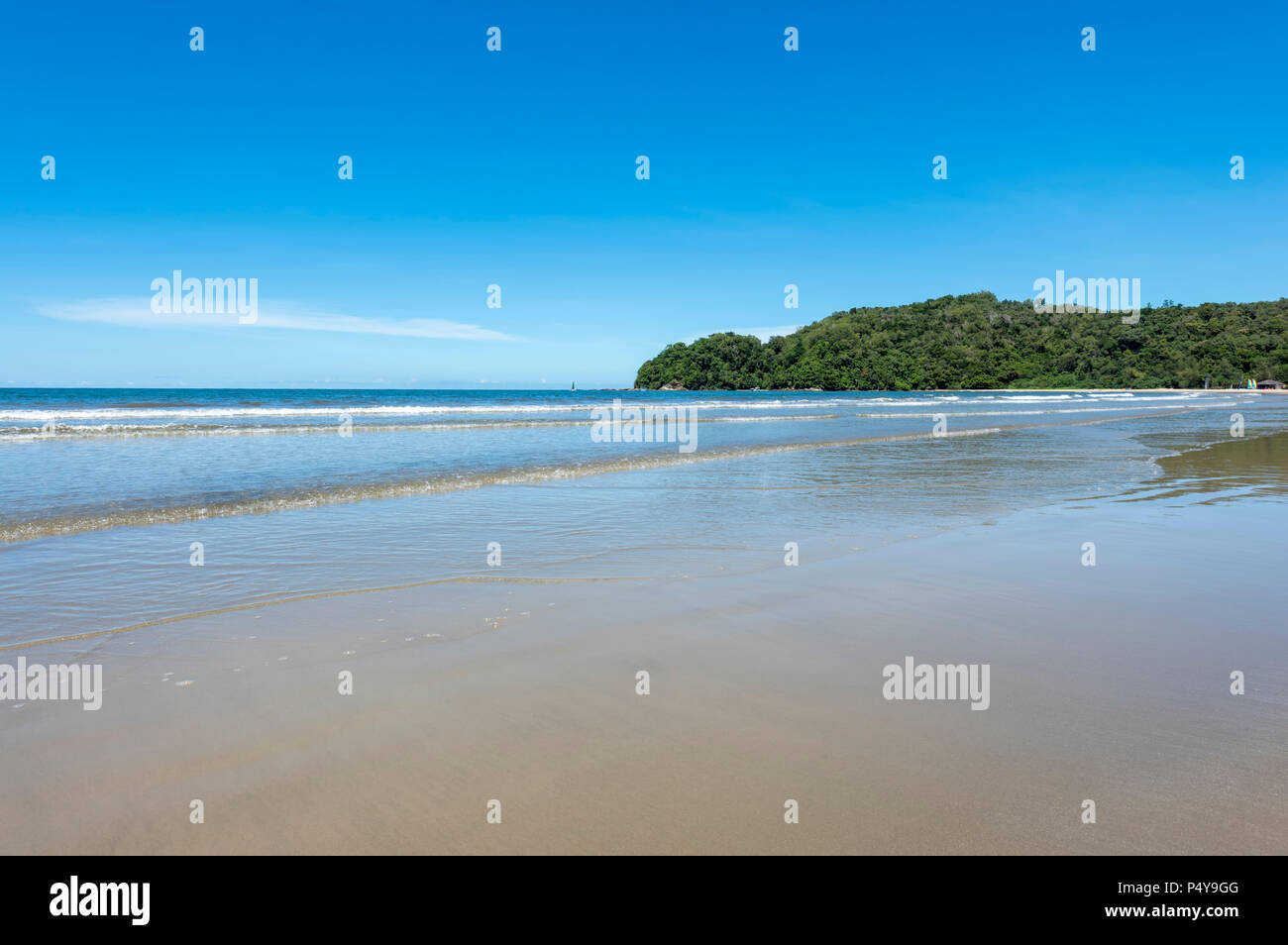 Waves from the South China Sea break on to the beach in Kota Kinabalu, Borneo, Malaysia Stock Photo