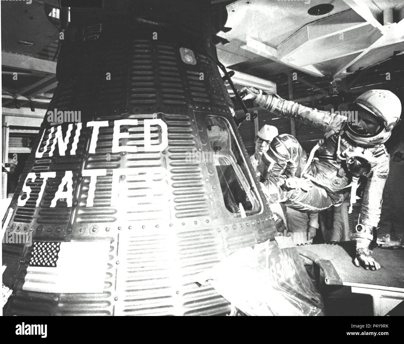 Astronaut John H. Glenn, Jr., pilot of the Mercury-Atlas 6 (MA-6) space flight, enters the Mercury Friendship 7 spacecraft during the MA-6 pre-launch preparations at Cape Canaveral - Stock Image