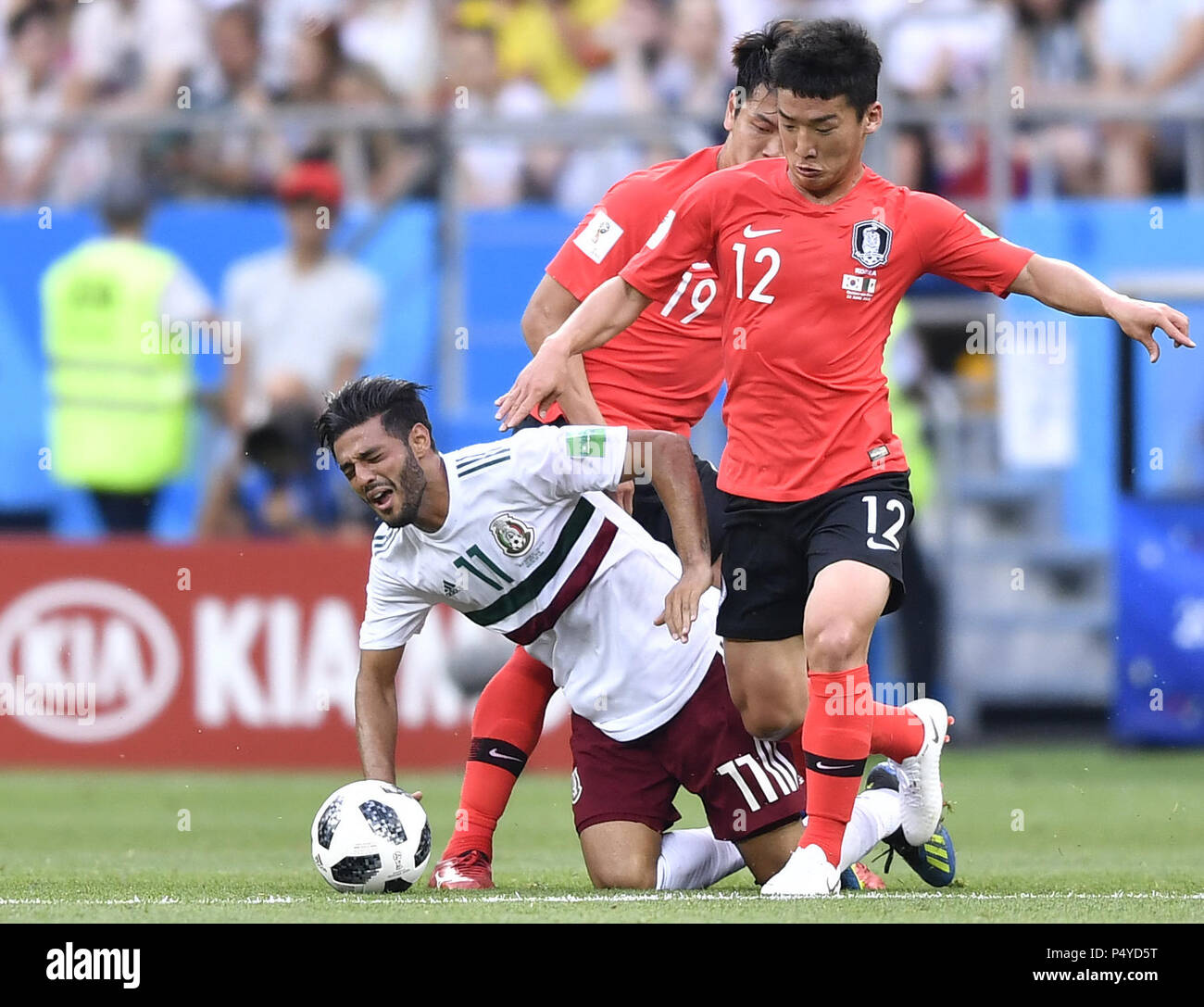 fbf912e079b Kim Minwoo (R) of South Korea vies with Carlos Vela of Mexico during the  2018 FIFA World Cup Group F match between South Korea and Mexico ...
