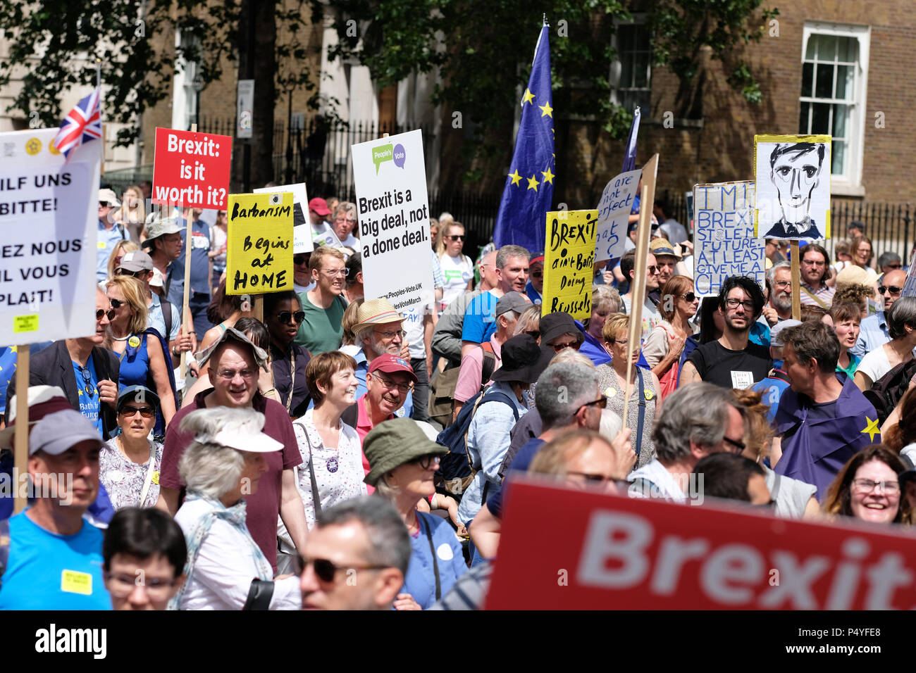 People's Vote, London, UK,  23rd June 2018.  Protestors march along Whitehall on a very hot summers day ( see man with paper hat ) en route Parliament Square to demand a second vote on the final Brexit deal - Steven May /Alamy Live News Stock Photo