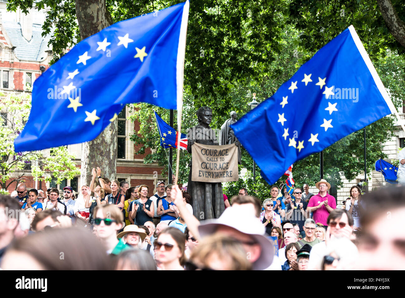 London, UK. 23rd June, 2018. The statue of Millicent Fawcett between European Union Flags. A coalition of pro-EU groups organized a march to parliament to demand a People's Vote on Brexit deal and whatever the government proposes on its future relationship with the EU. Credit: SOPA Images Limited/Alamy Live News - Stock Image