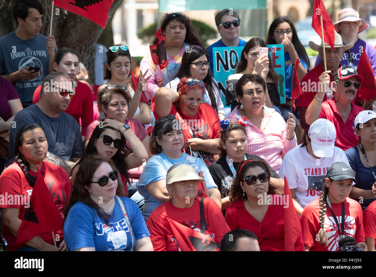 Protesters listen to Kerry Kennedy, director of the Robert F. Kennedy Center for Justice and daughter of Robert and Ethel Kennedy,as she kicks off a 24-day hunger strike during a rally in McAllen TX protesting Pres. Donald Trump's policy of separating immigrant families at the US-Mexico border.. - Stock Image