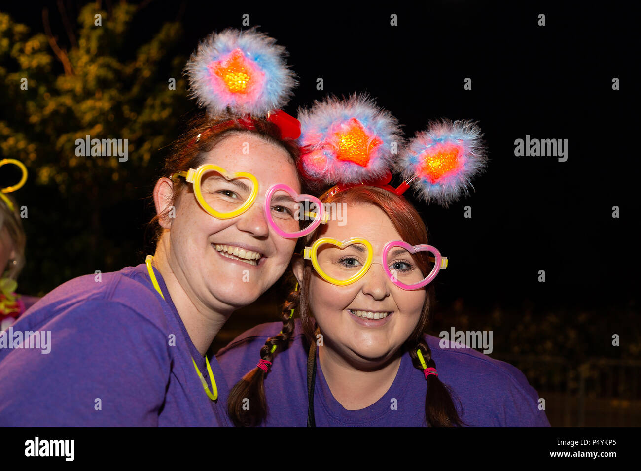 Warrington, UK. 23rd June, 2018. 23 June 2018 - Starlight Ladies Walk, a sponsored ladies-only walk which begins at midnight at the Orford Jubilee Neighbourhood Hub. The aim is to raise as much money as possible for St. Rocco's Hospice a Registered Charity that provides specialist care and support across Warrington, helping those who are coping with a life-limiting illness. Credit: John Hopkins/Alamy Live News - Stock Image