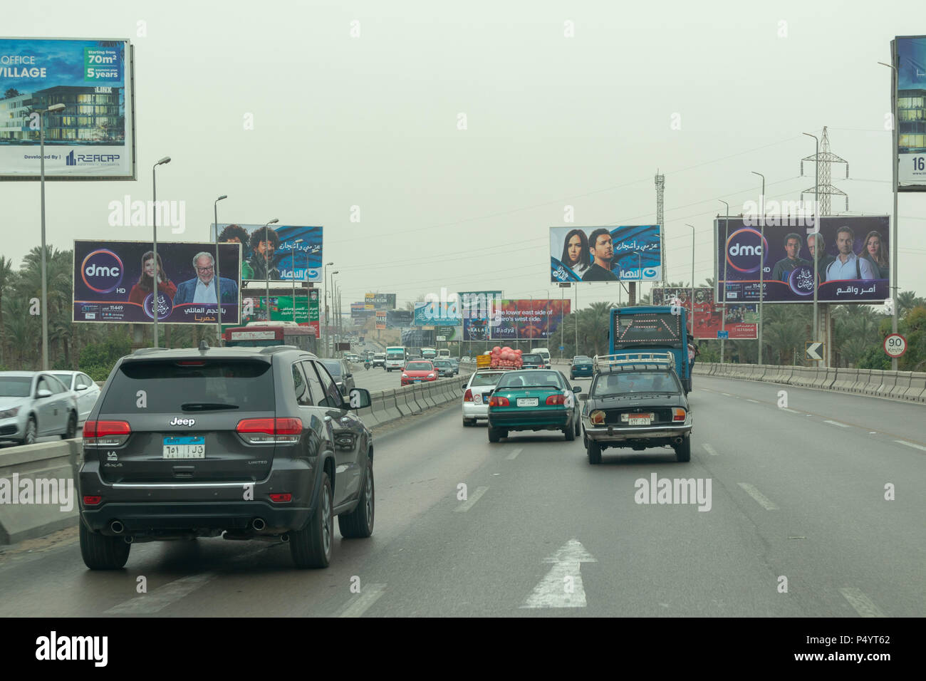 arterial road in Cairo, Egypt showing proliferation of billboards with advertising. - Stock Image