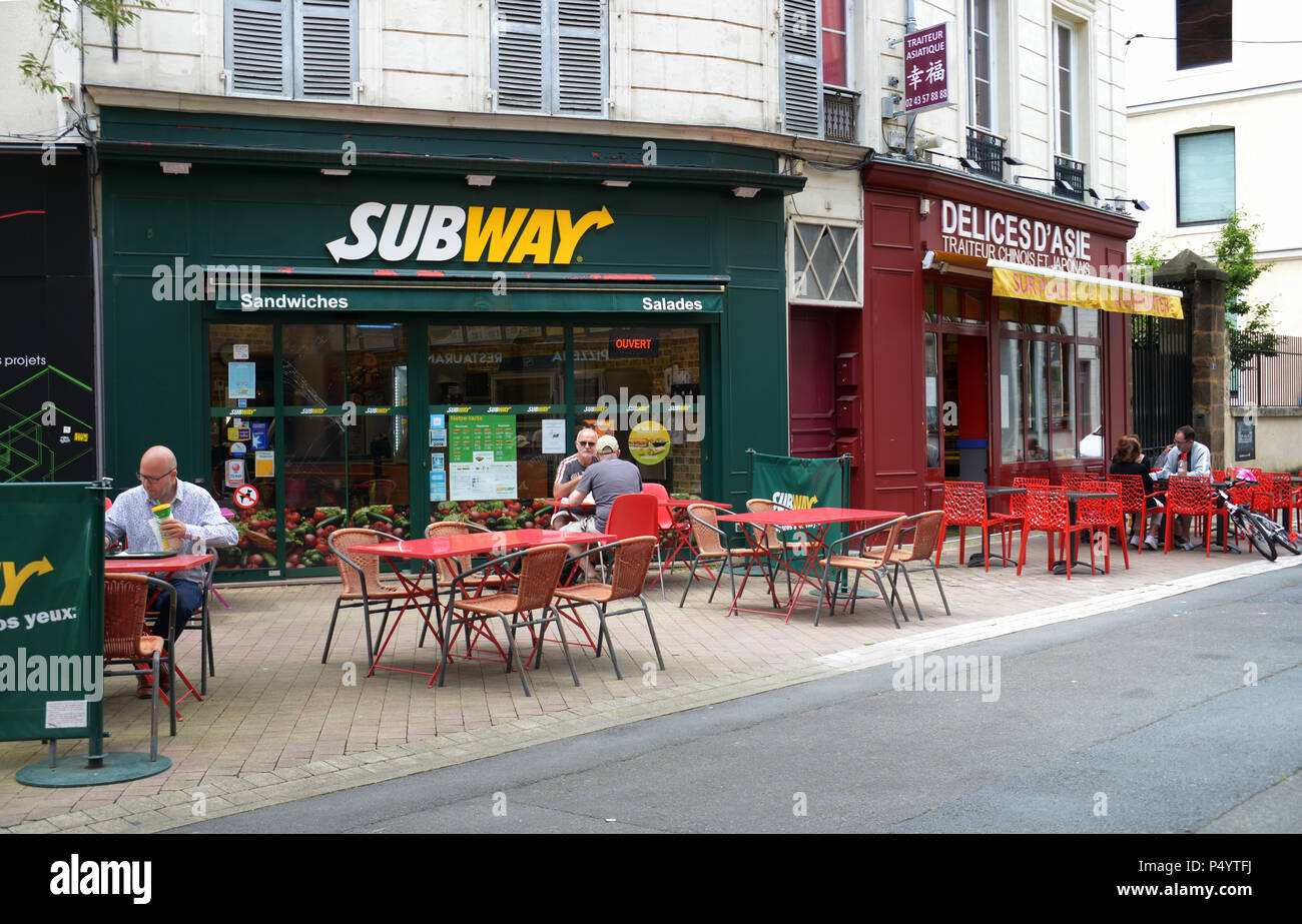 Subway sandwiches outlet in Le Mans, France. Relaxed sunny sunday customers enjoying lunch in Le Mans - Stock Image