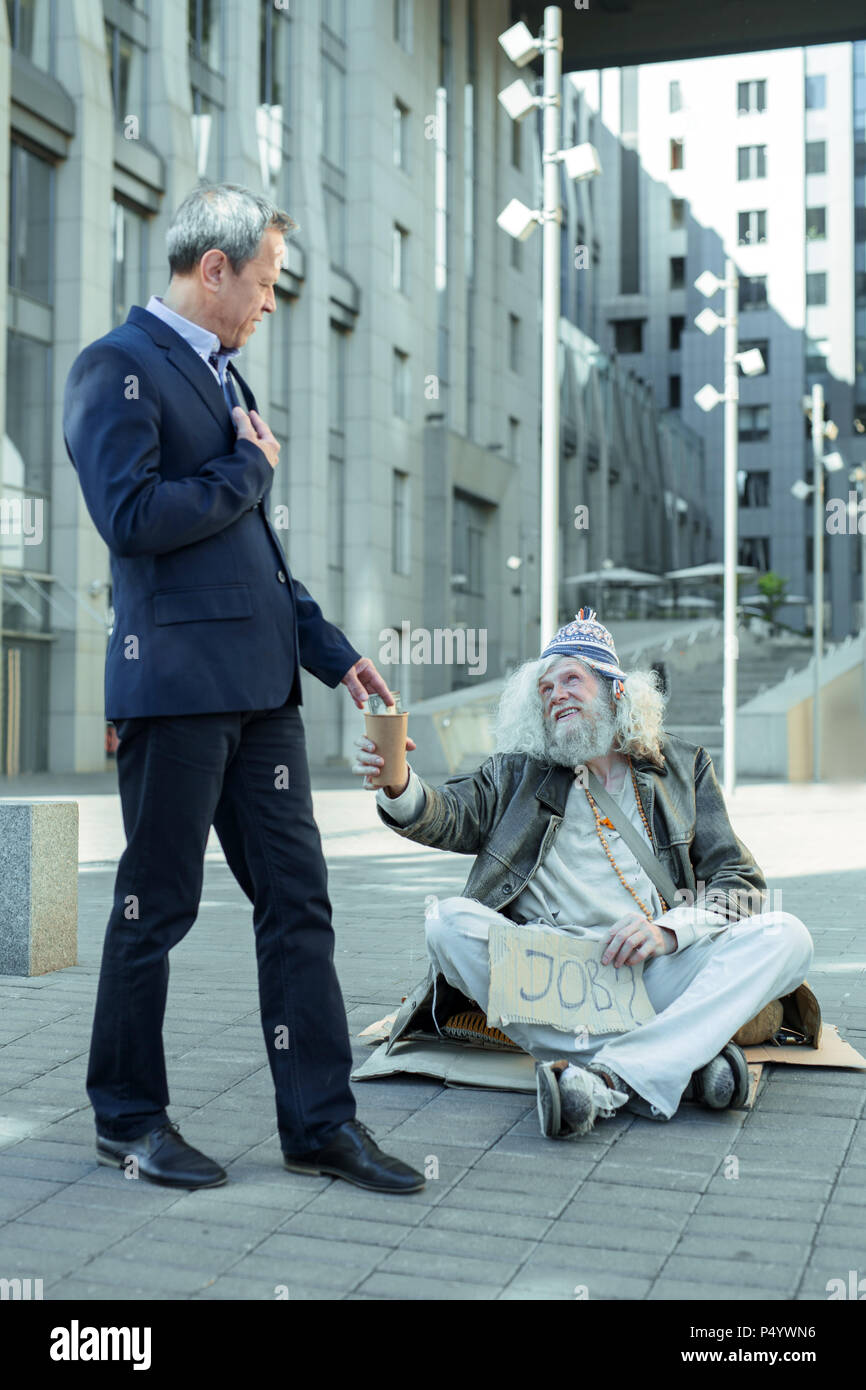 Helping The Poor Stock Photos & Helping The Poor Stock Images - Alamy