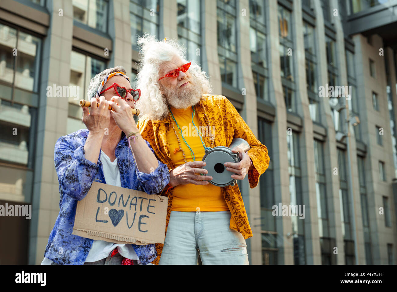 Two inspired hippies acting in street performance - Stock Image