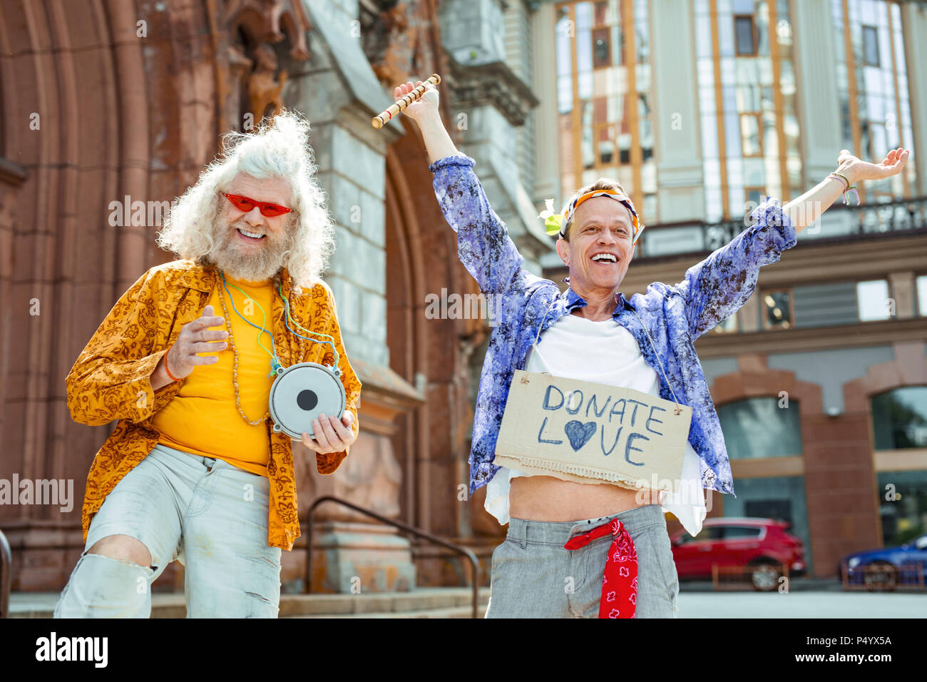 Positive active hippies feeling simply unbelievable - Stock Image