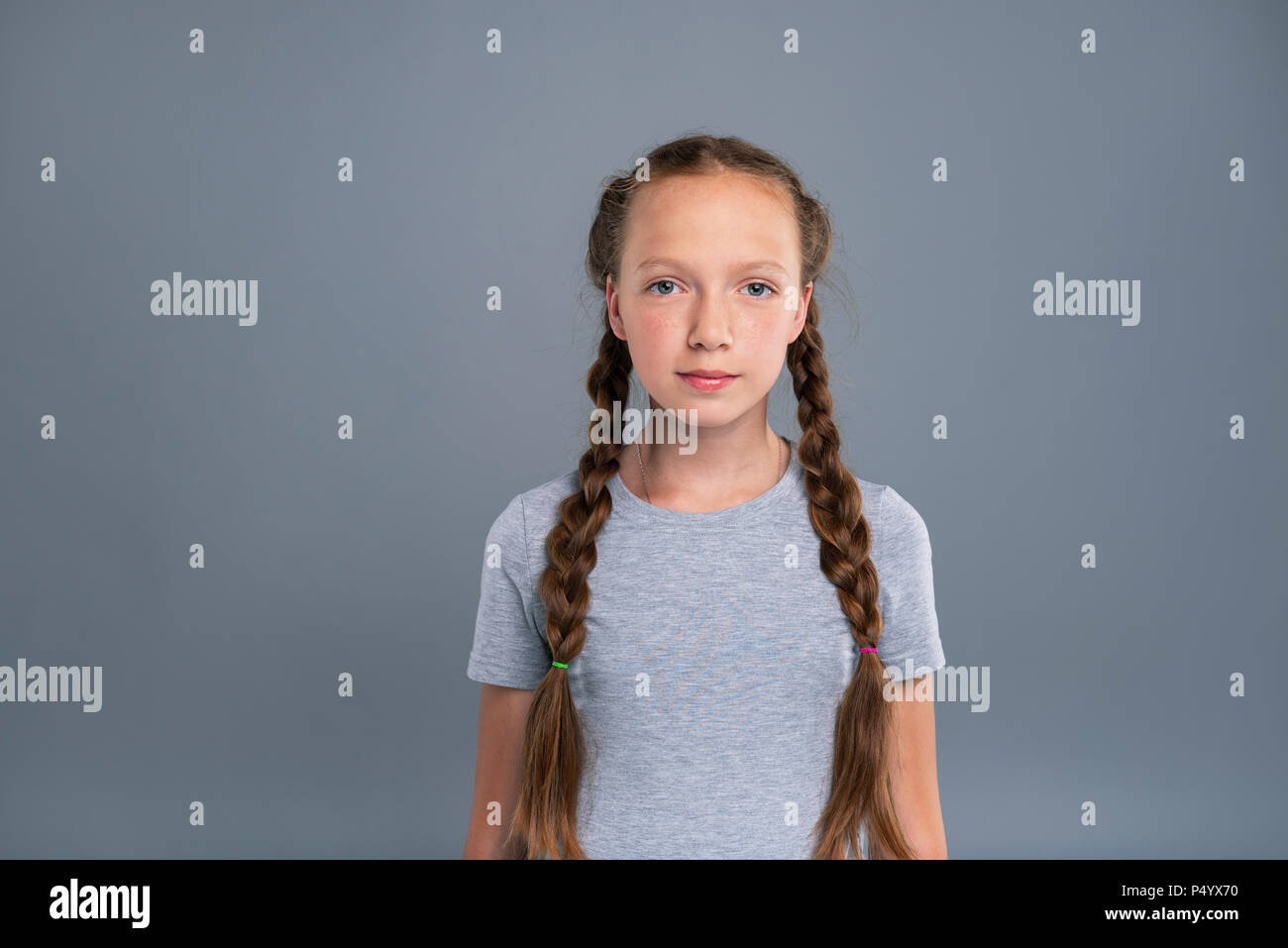 Portrait of a pretty teenage girl with two braids - Stock Image