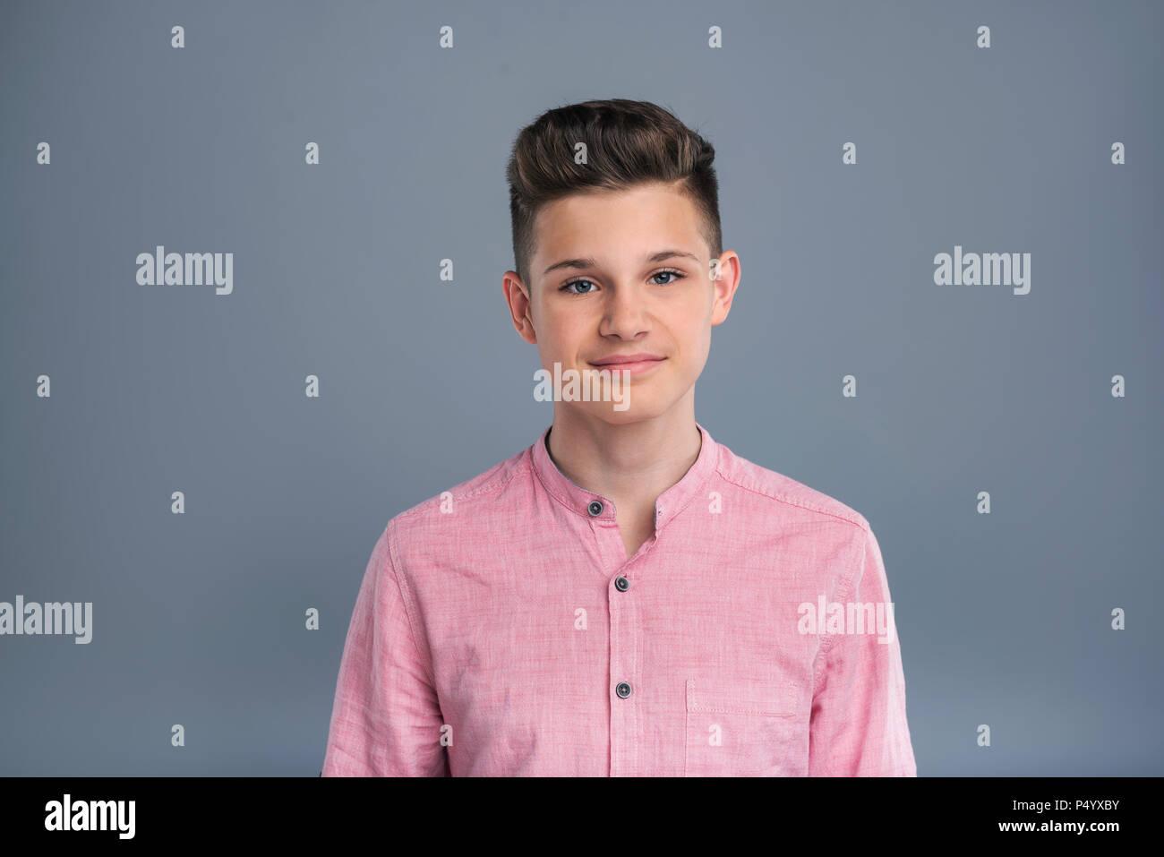 Portrait of a handsome teenage boy - Stock Image