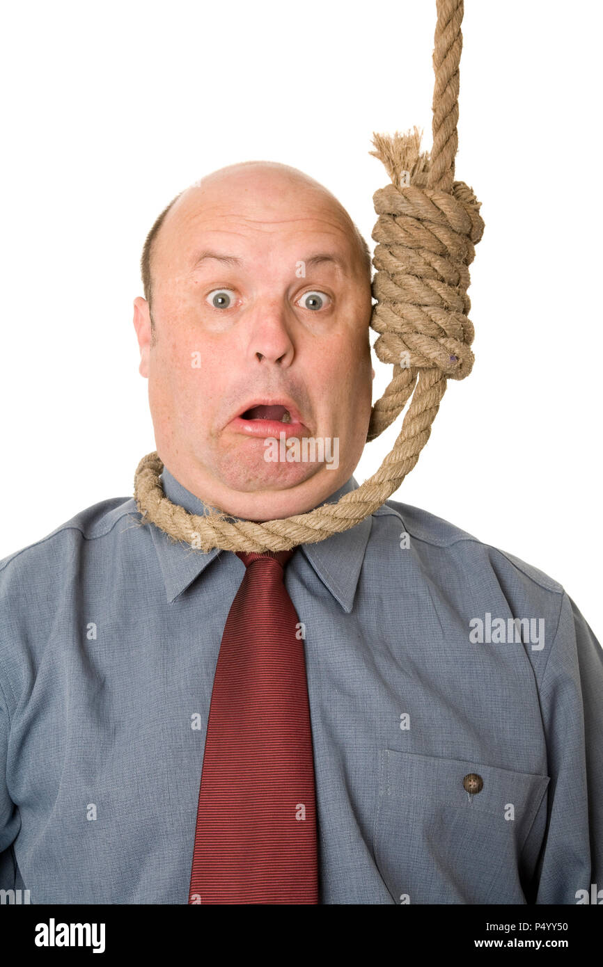 A businessman in noose, a cut backs, financial crisis concept. - Stock Image