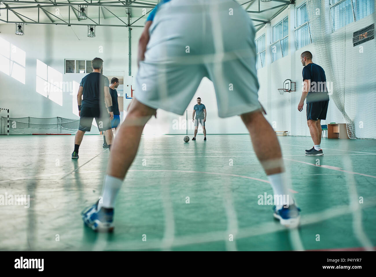 Men playing indoor soccer - Stock Image