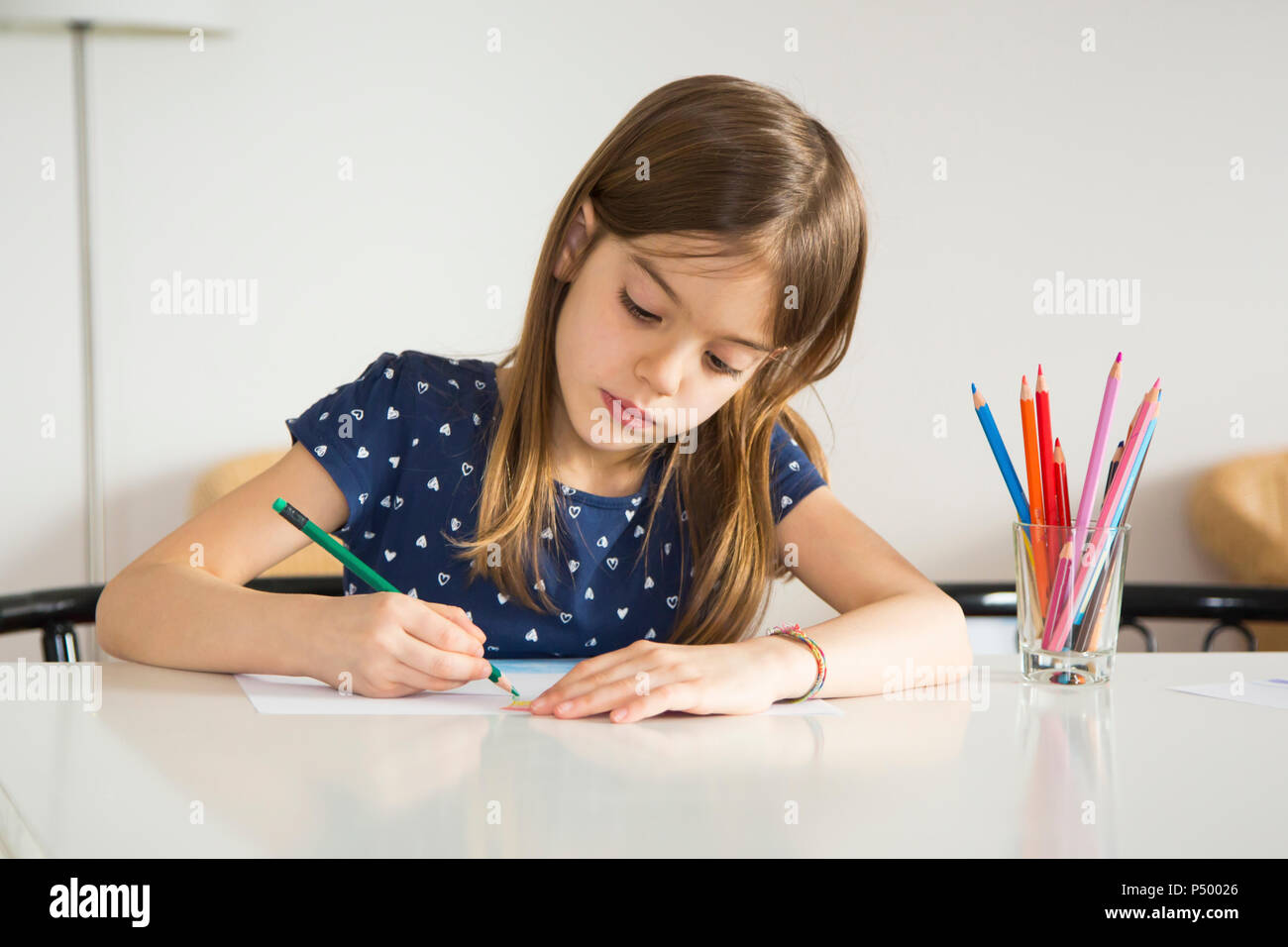 Portrait of little girl drawing - Stock Image