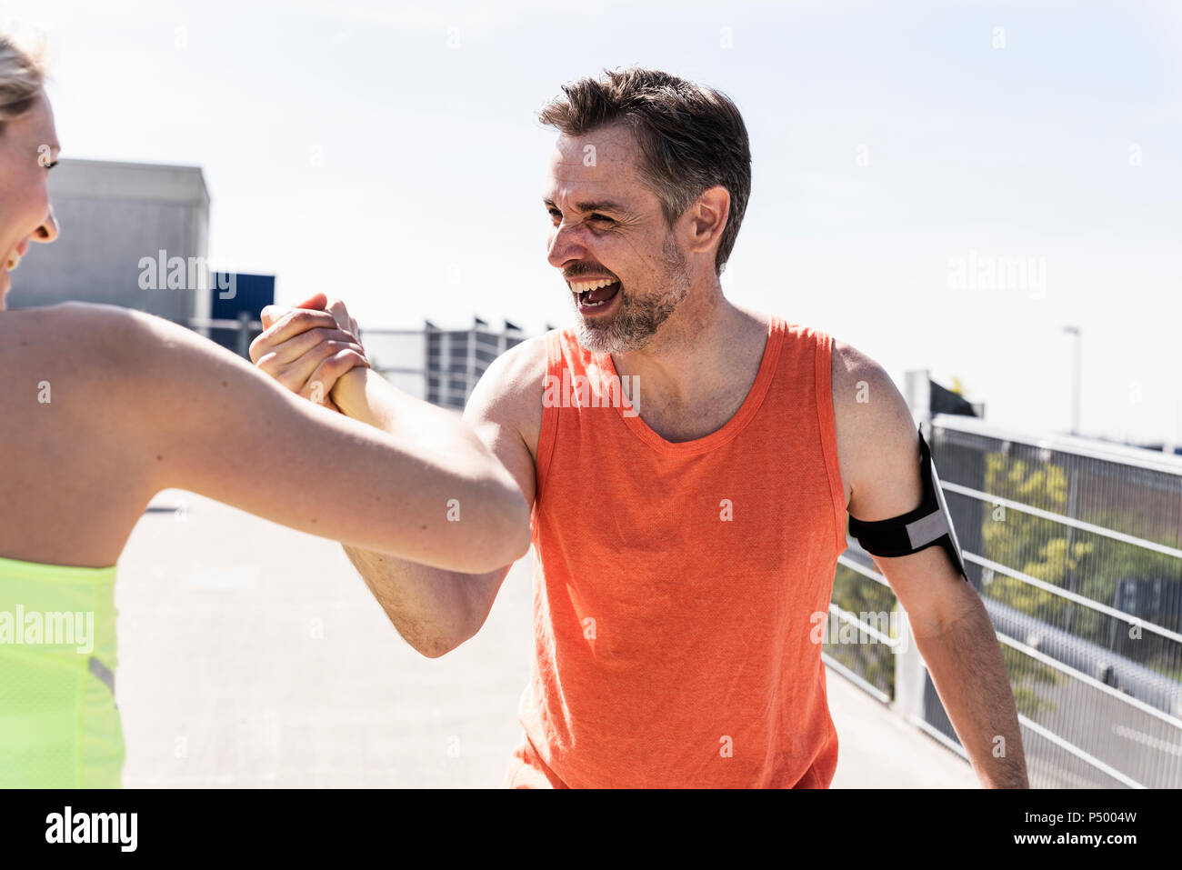 Couple working out together, having fun - Stock Image