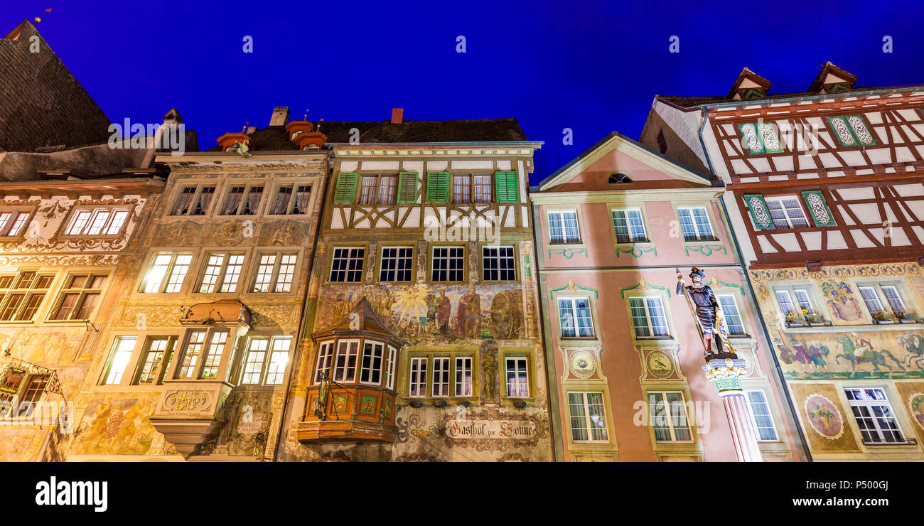 Switzerland, Stein am Rhein, Old town, historical houses at townhall square, fresco paintings, blue hour - Stock Image