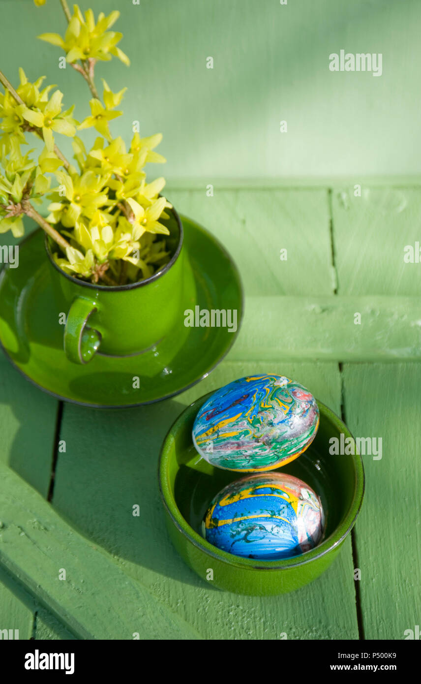 Easter eggs painted with nail varnish in bowl - Stock Image