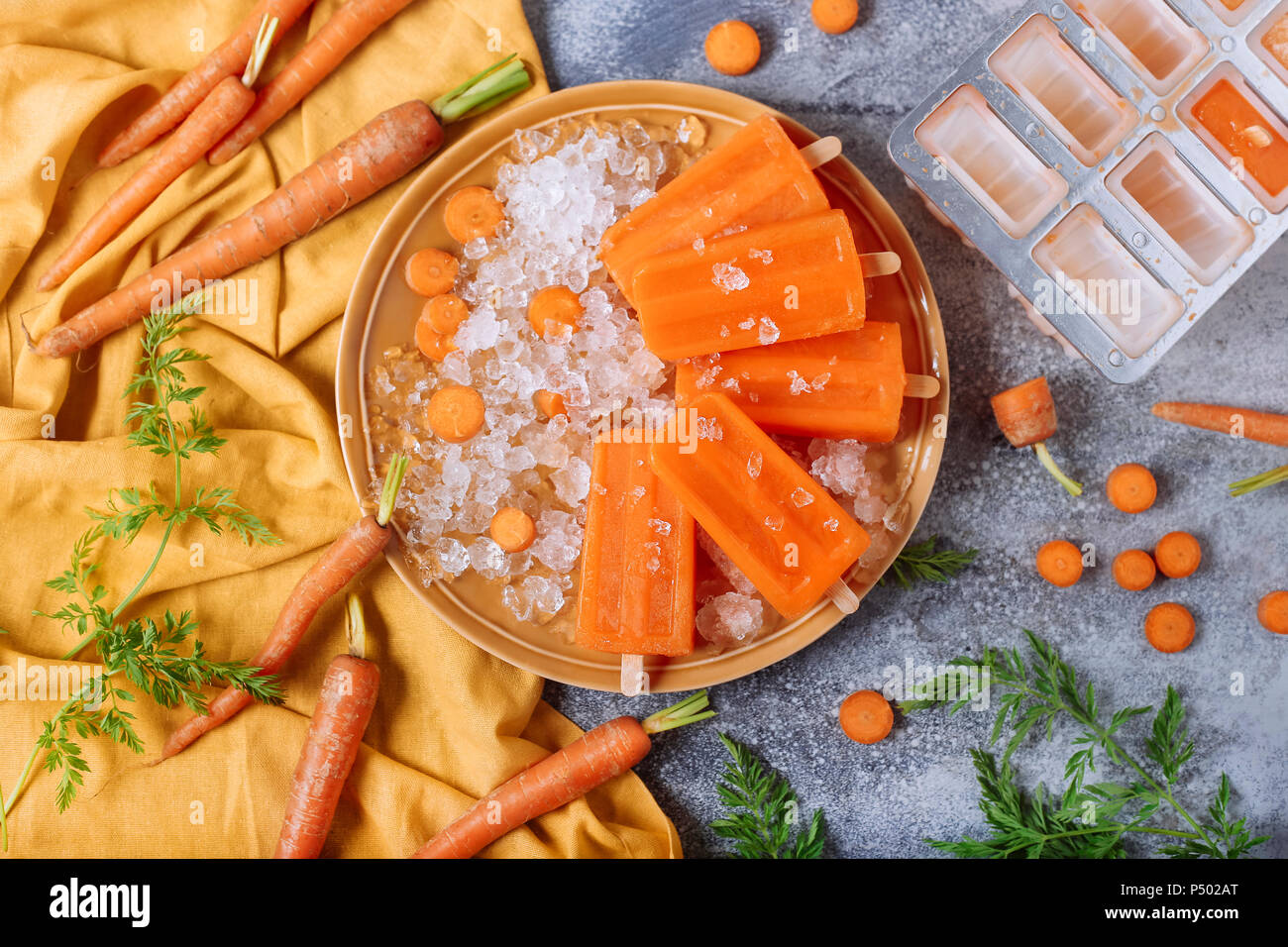 Carrot ice lollies - Stock Image