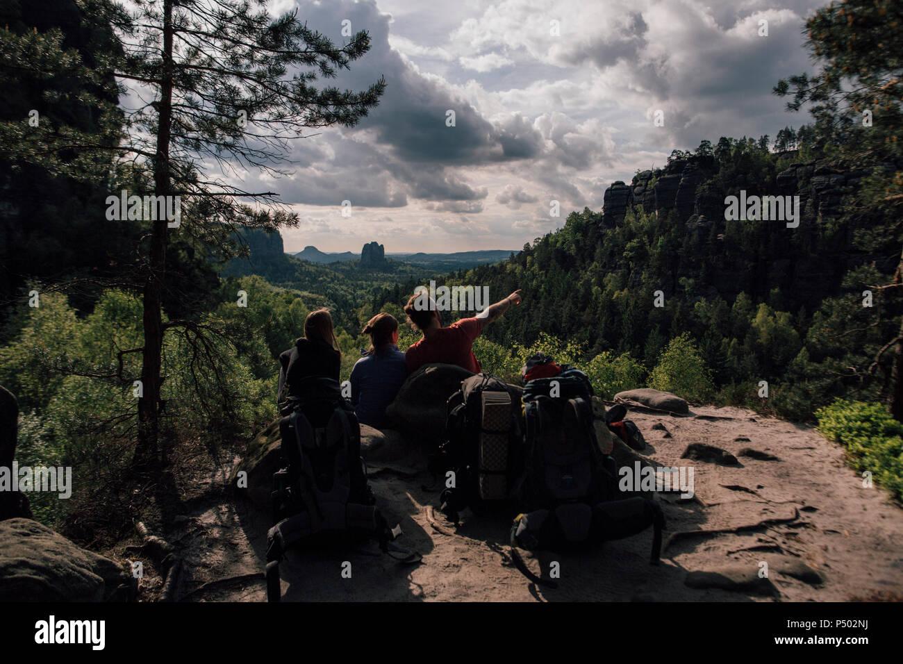 Germany, Saxony, Elbe Sandstone Mountains, friends on a hiking trip having a break - Stock Image