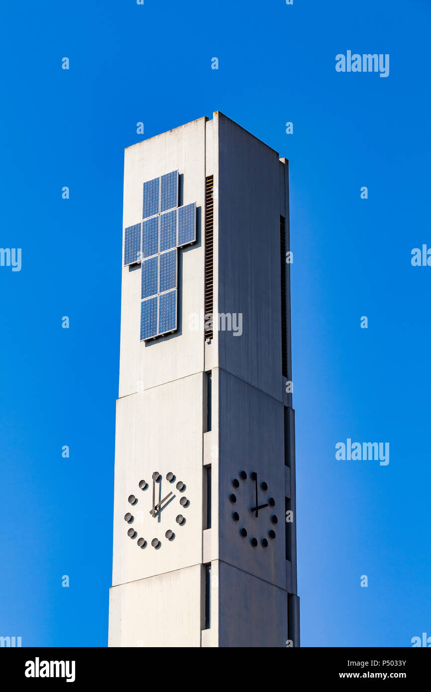 Germany, Gaienhofen, spire of Melanchthonkirche with solar panels building cruz - Stock Image