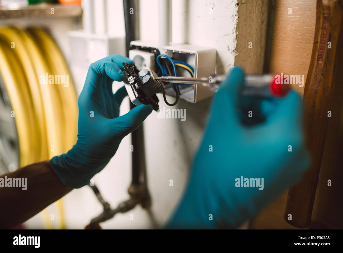 Detail of a man working on an electrical installation - Stock Image