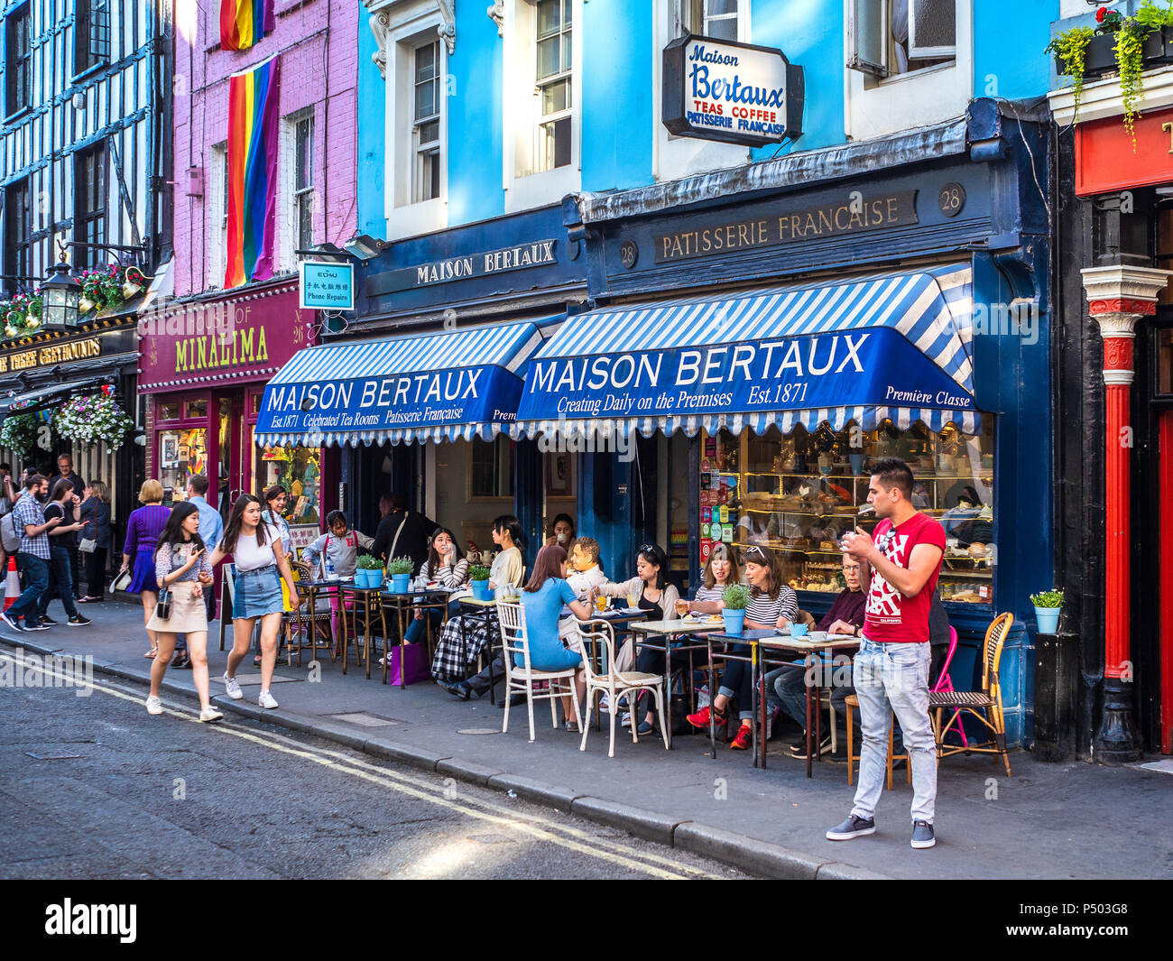 Maison Bertaux in Greek Street Soho, founded in 1871 by a Monsieur Bertaux from Paris, is the oldest pâtisserie shop in London. Soho Life, Soho Living - Stock Image