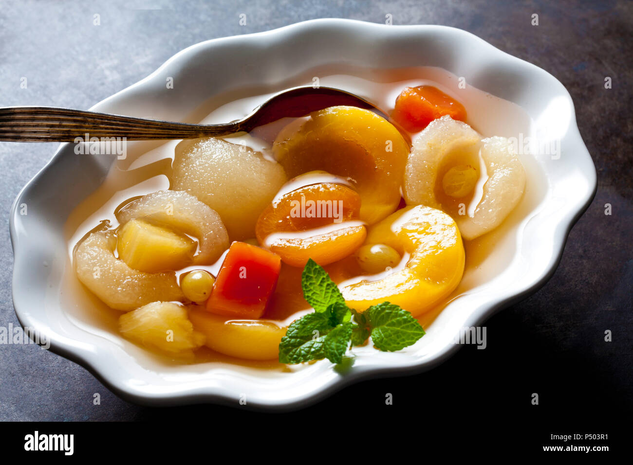 Preserved fruit salad in bowl - Stock Image