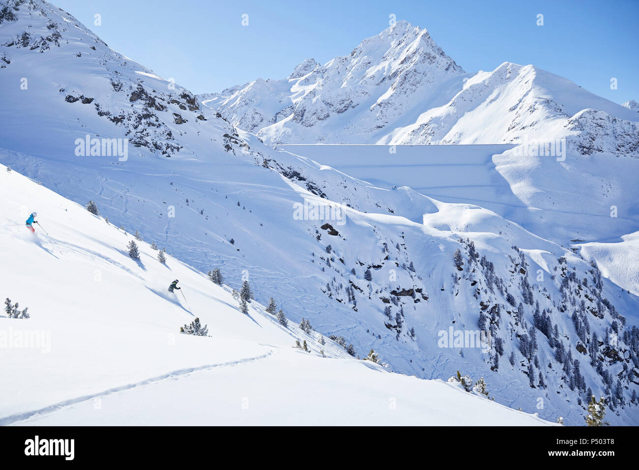 Austria, Tyrol, Kuehtai, couple skiing in winter landscape - Stock Image