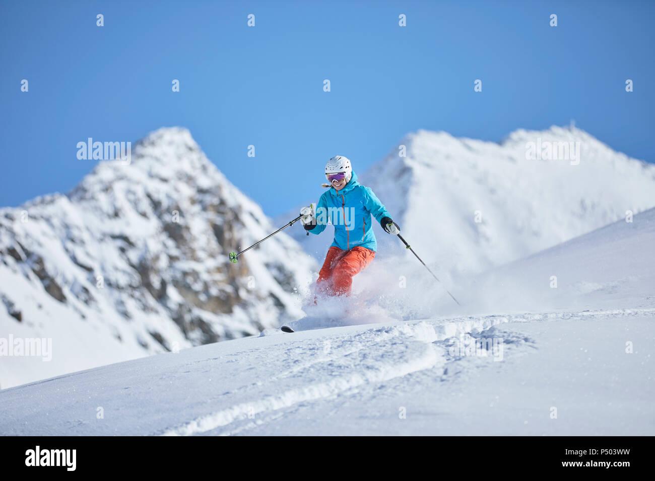 Austria, Tyrol, Kuehtai, woman skiing in winter landscape - Stock Image