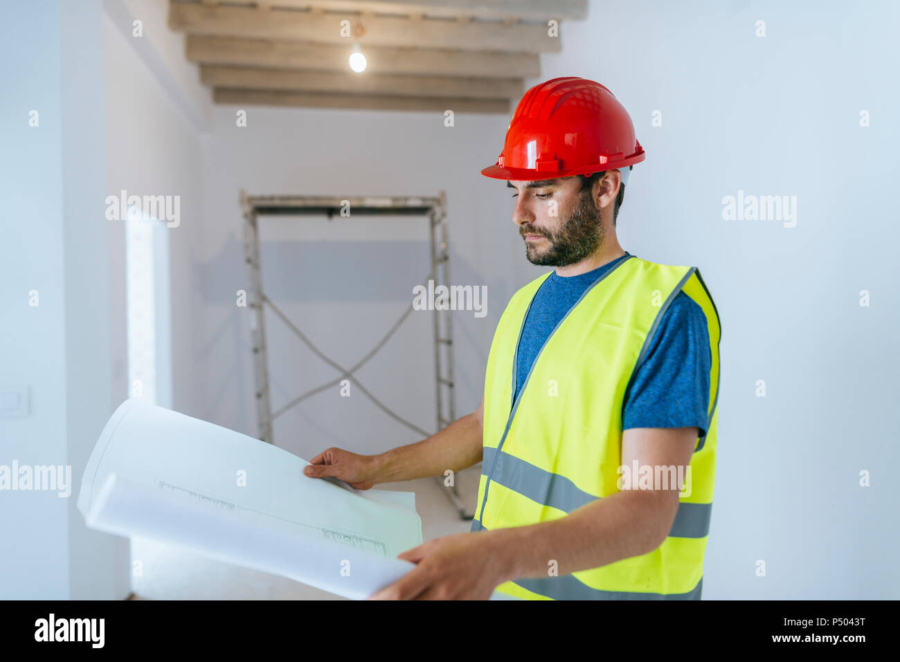Worker looking at the plane - Stock Image