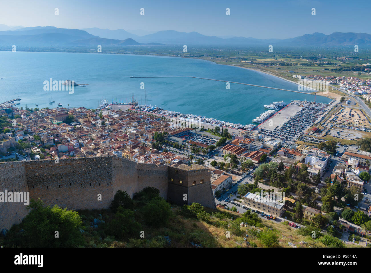 Nafplio city view from Palamidi castle with Bourtzi caslte in the background - Stock Image
