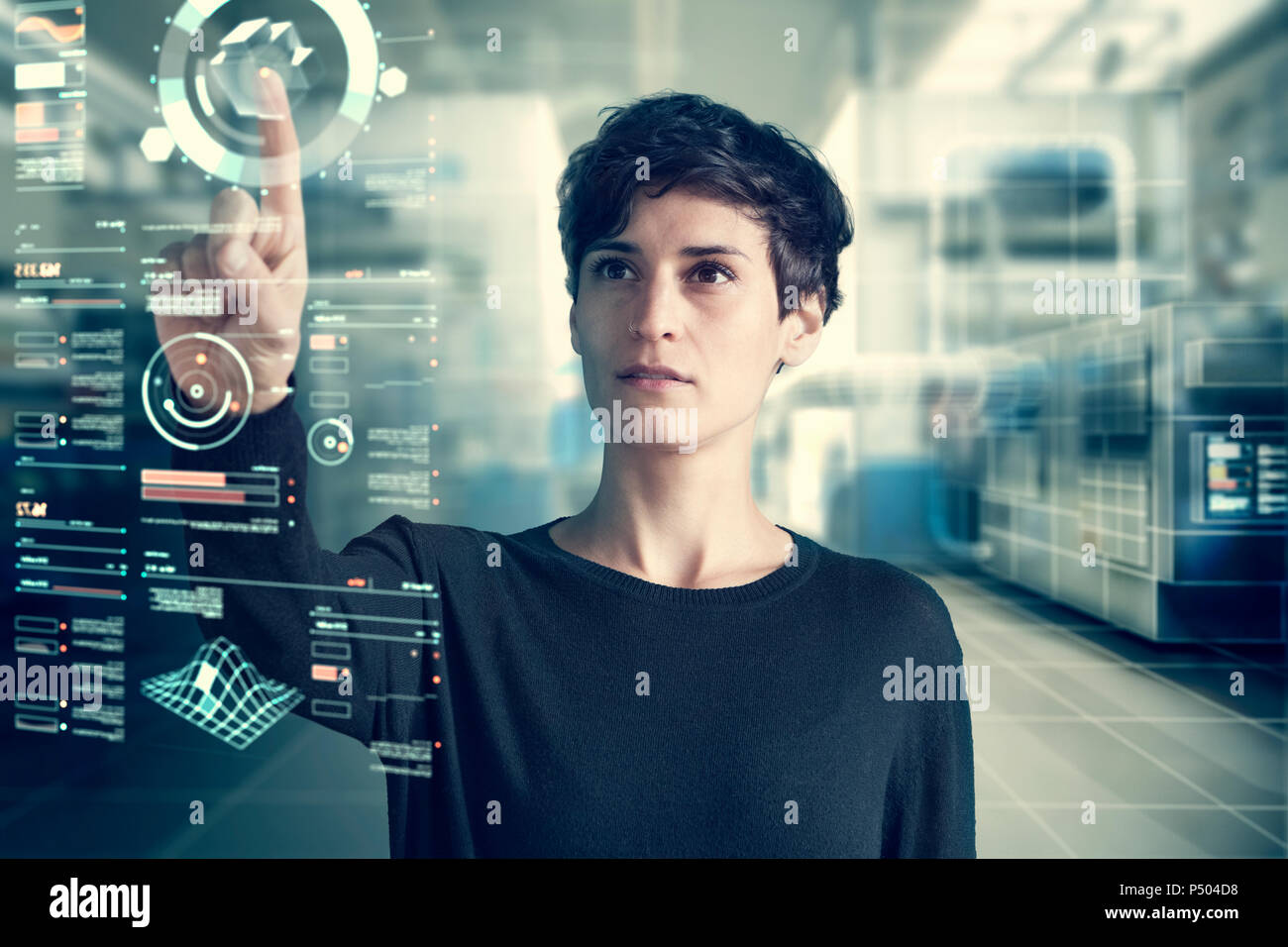 Young woman using transparent touchscreen display, Composing - Stock Image