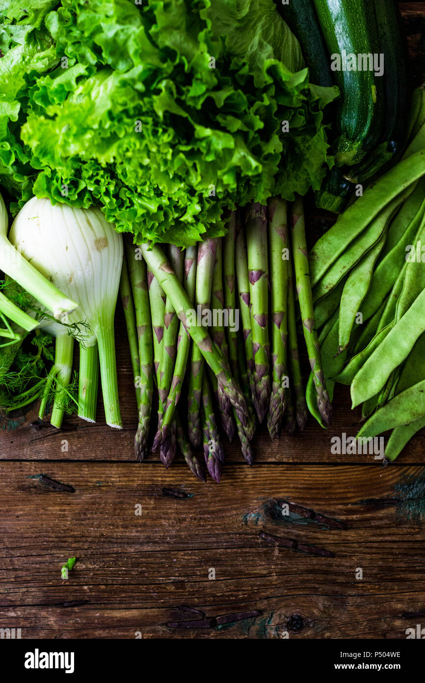 Green asparagus, salad, zucchini, fennel and pea pods Stock Photo