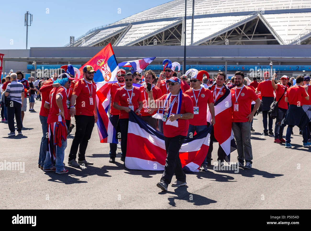 Samara, Russia - June 17, 2018: Merry and decorated football fans with flags of Costa Rica next to the Samara Arena stadium during the 2018 FIFA World - Stock Image