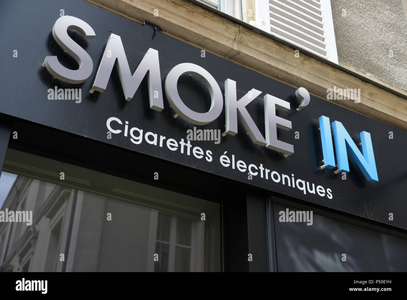 Smoke in the electronic cigarette shop in the centre of Le Mans - Stock Image