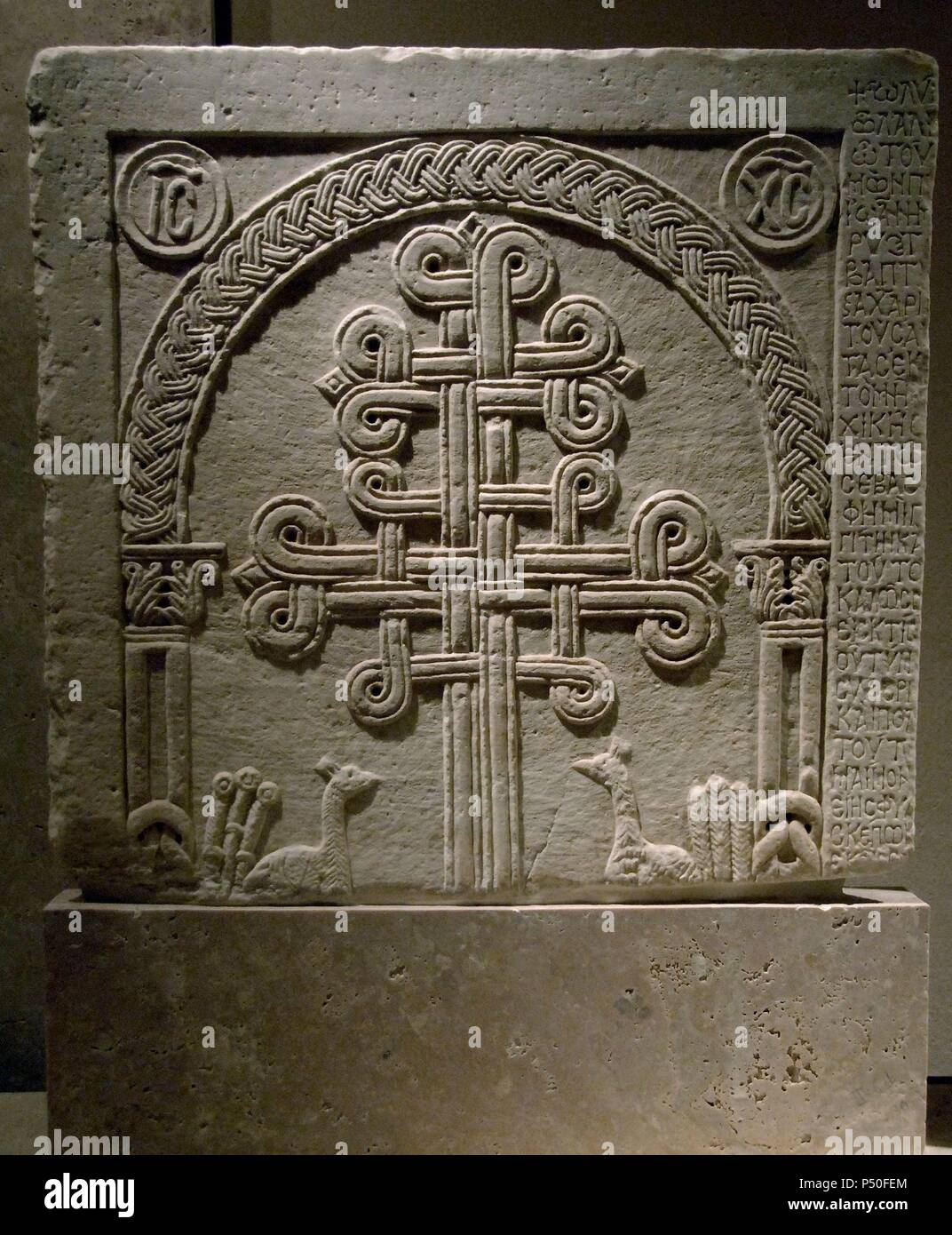 BYZANTINE ART. GREECE. Marble slab with lateral inscription and reliefs about intertwined crosses. Dated from latest XI century and early XII century. Byzantine Museum. Athens. - Stock Image