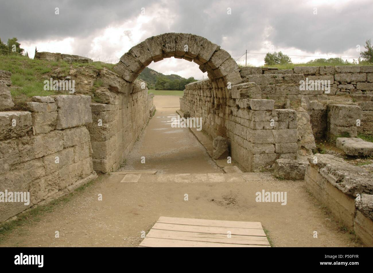 Greek Art. Sanctuary of Olympia. Olympic stadium.  The vaulted tunnel leading into the stadium. Hellenistic period. Elis. Peloponesse. Greece. - Stock Image