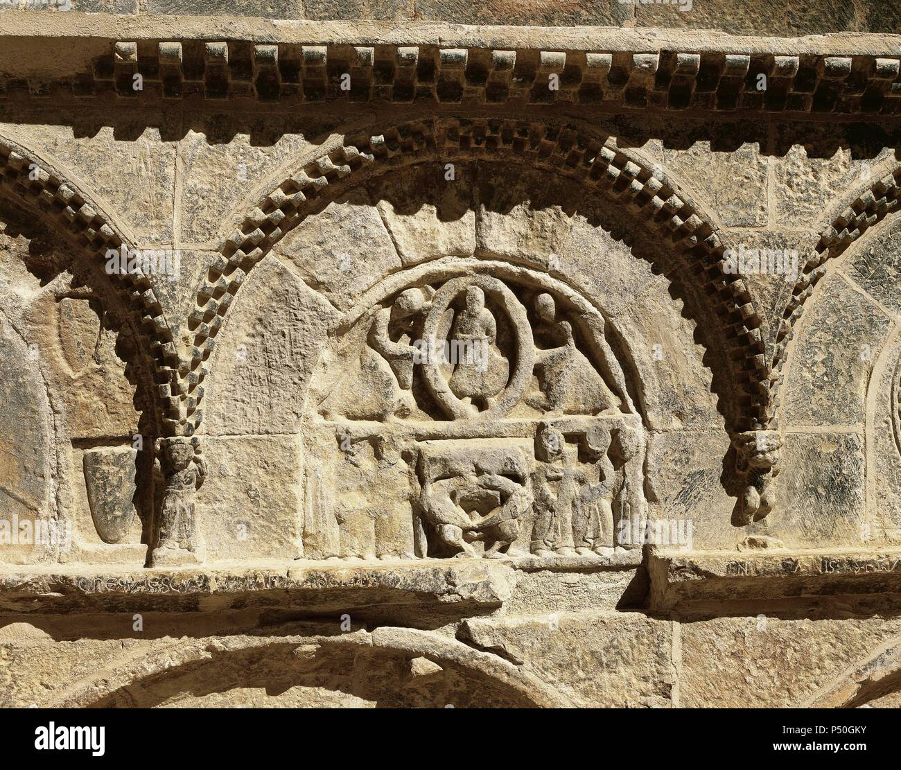 Monastery of San Juan de la Pena. Pantheon of the Nobles. Detail of an relief depicting two angels raising the soul of the deceased in mandorla. At the bottom, Epiphany. Aragon. Spain. - Stock Image