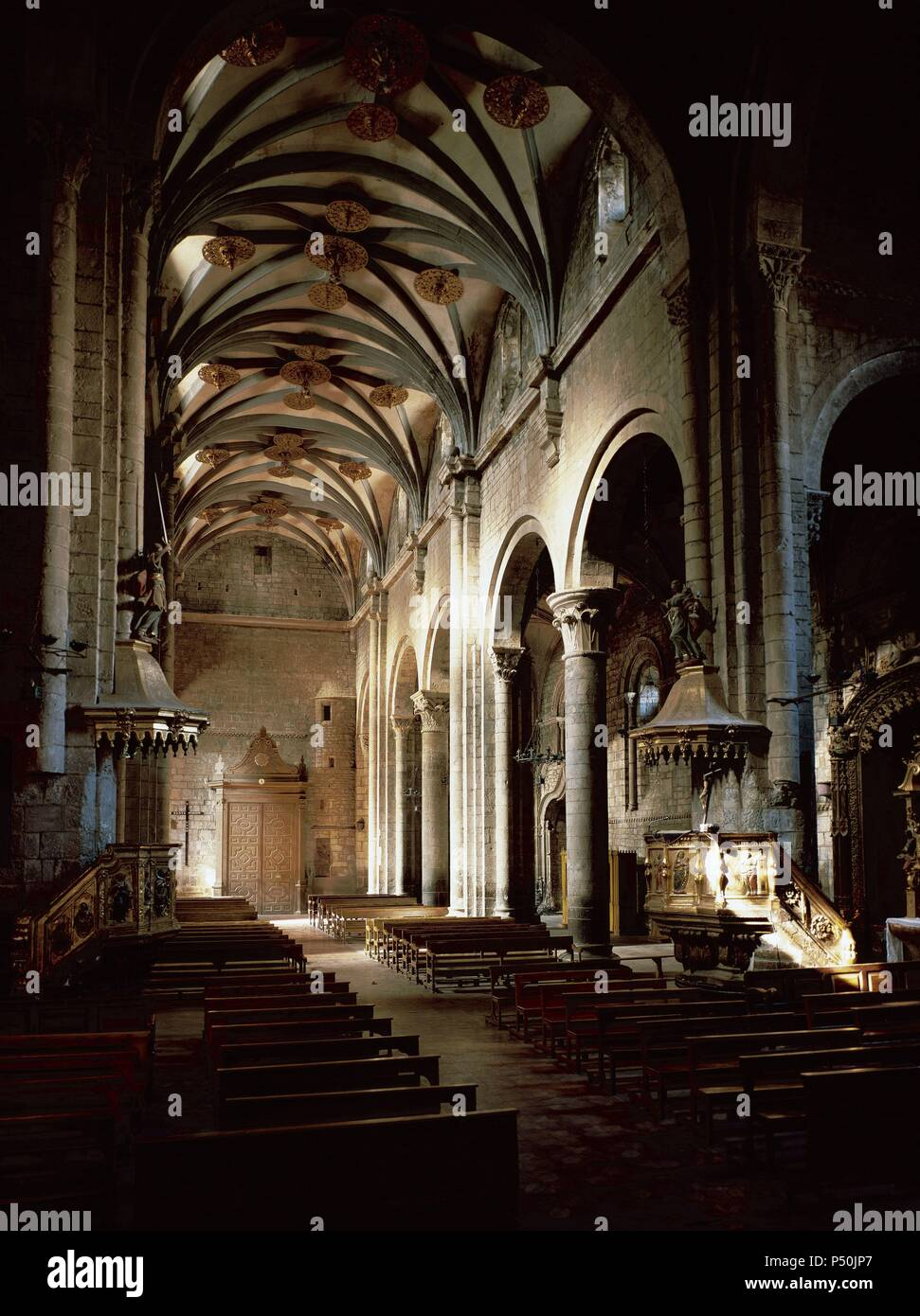 Saint Peter's Cathedral. Romanesque temple built during the kingdom of Ramiro I (1035-1063), king of Aragon. XI century. Inside view. Central nave. Jaca. Aragon. Spain. - Stock Image
