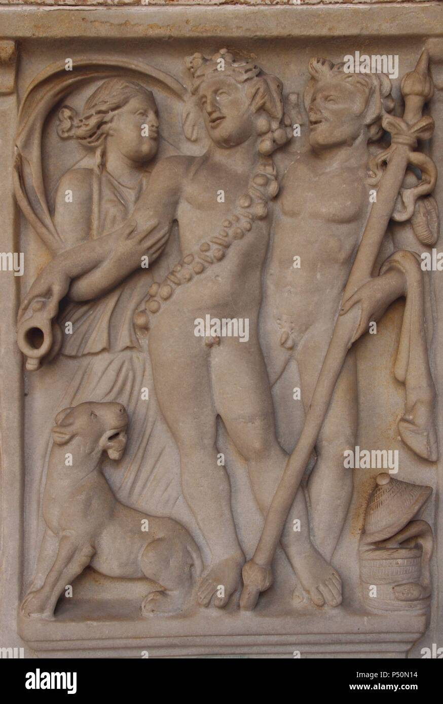 Dionysus, god of wine. Relief of roman sarcophagus depicting Dionysos with Maenad, satyr and Panther. Vatican Museums. City of the Vatican. Stock Photo